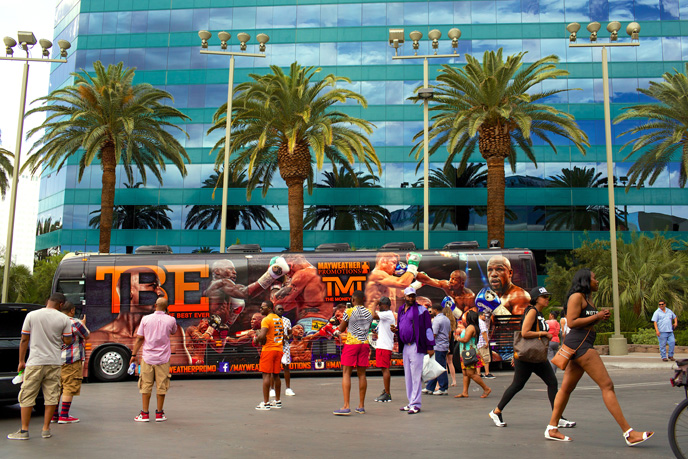 Fans take pictures with Floyd Mayweather's bus in front of the MGM Grand in Las Vegas on Saturday, May 2, 2015.
